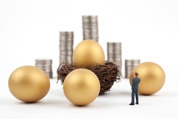 Golden egg and business man on white background
