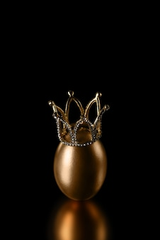 Golden egg with golden crown