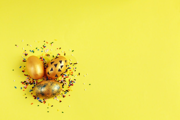Golden eggs with colorful candy sprinkles