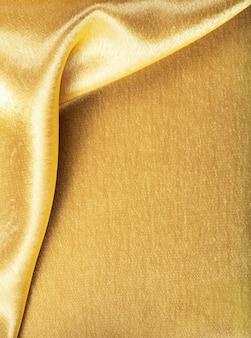 Текстура шелка золотой ткани