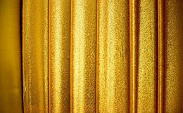 金色の生地のテクスチャ背景
