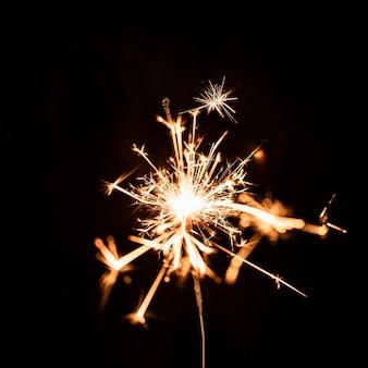 Golden firework at night on sky