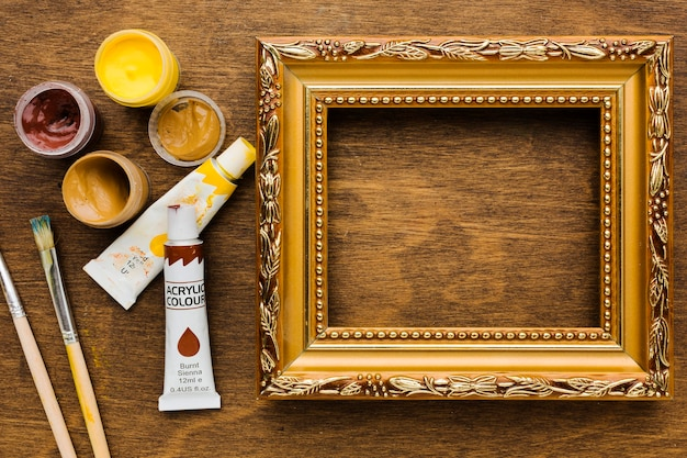 Golden frame surrounded by paint