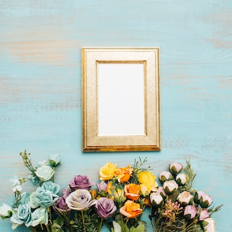 Golden frame with flowers.