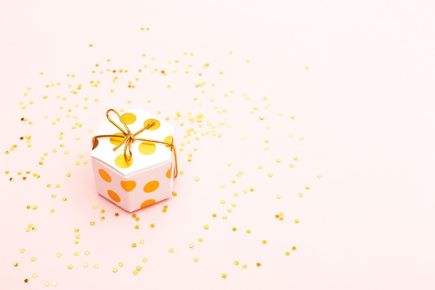 Golden gift box and confetti