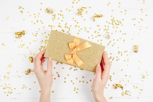 Golden gift box with confetti