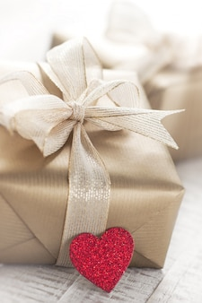 Golden gift packets with a red heart