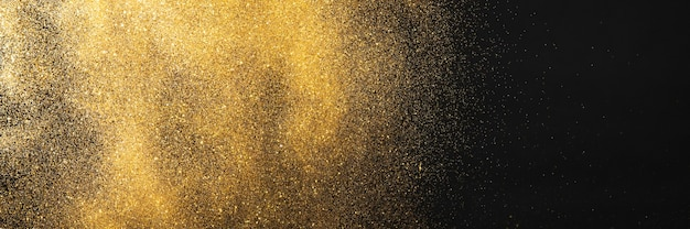 Golden glitter on black background