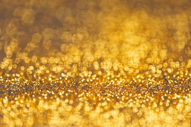 Golden glitter bokeh elegant abstract background