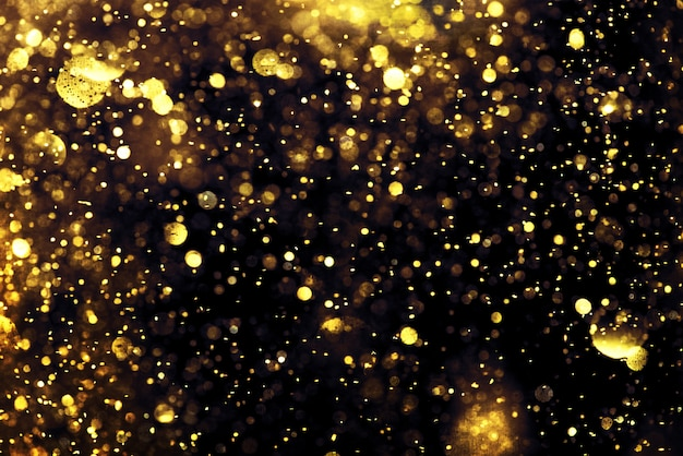 Golden glitter bokeh lighting texture blurred abstract background for birthday, anniversary, wedding