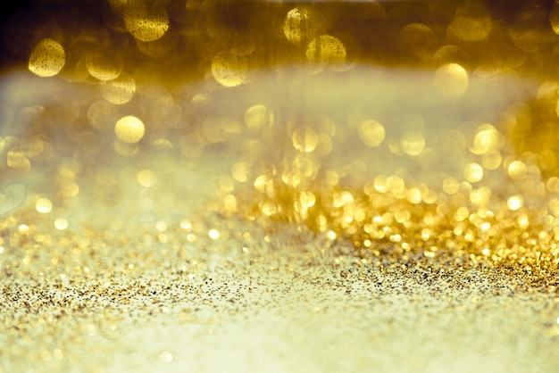 Golden glitter bokeh lighting texture blurred abstract background