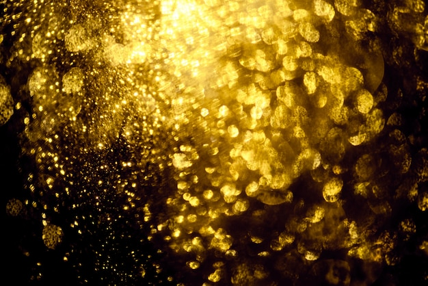 Golden glitter bokeh lighting texture blurred abstract background