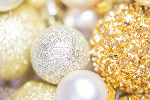 Golden glitter christmas abstract background, xmas gold decor holiday ball, blur background, shallow depth of field