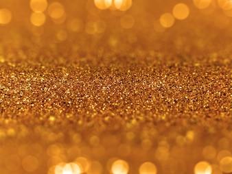 Golden glitter defocused bokeh background