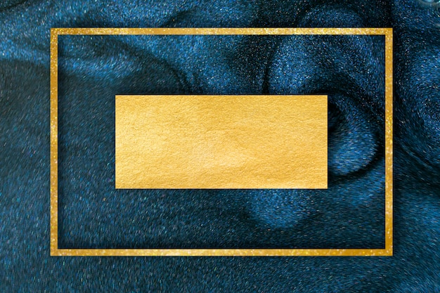 Golden glitter dust on dark blue background.