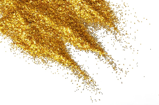 Golden glitter sand texture handful spread on white, abstract background with copy space.