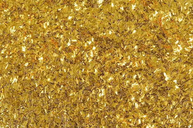 金色のキラキラテクスチャ、抽象的な背景。高解像度写真