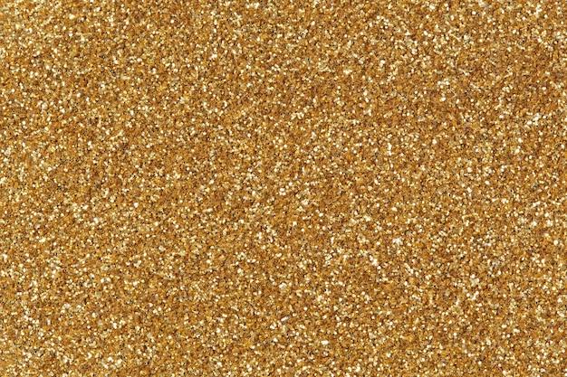 Золотой блеск текстуры фона. фотография высокого разрешения.