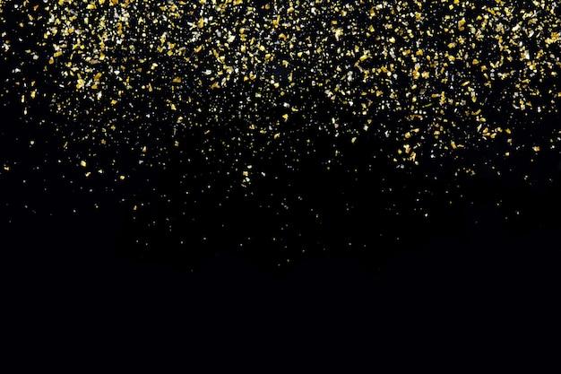 Golden glitter texture on black abstract background