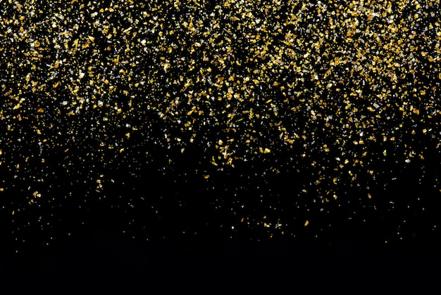 Golden glitter texture on black abstract wall