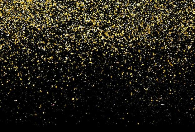 Golden glitter texture on black abstract