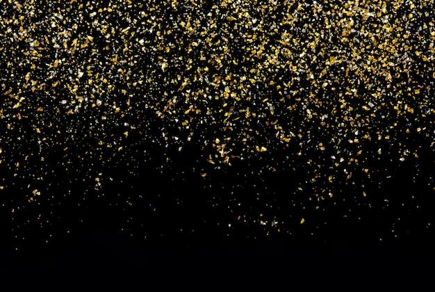 黒の抽象的な壁に金色のキラキラテクスチャ