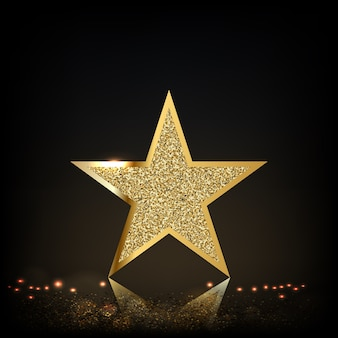 Golden glittering star isolated on a black background