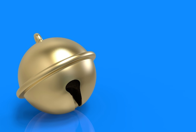 Golden jingle bell on blue copy space background.