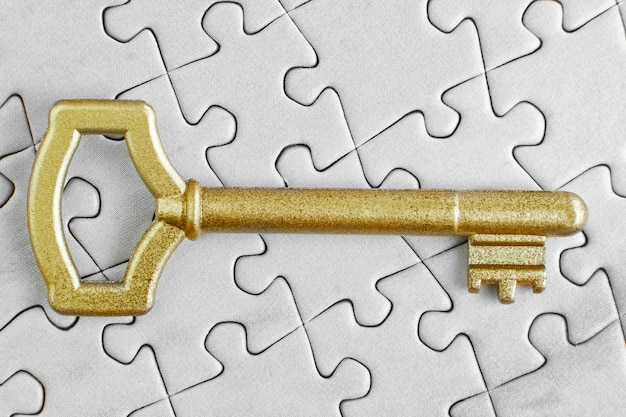 Golden key to the puzzle close-up.