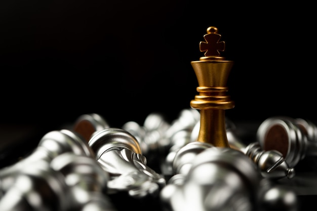 Golden king chess is last standing in the chess board, concept of successful business leadership