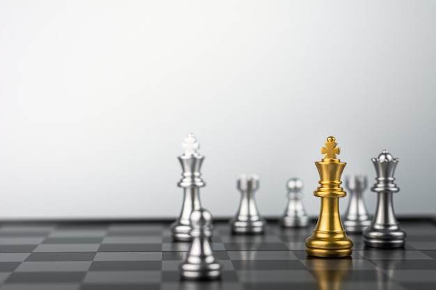 Golden king chess standing encounter enemies.