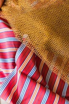 Golden lace on stripes garment