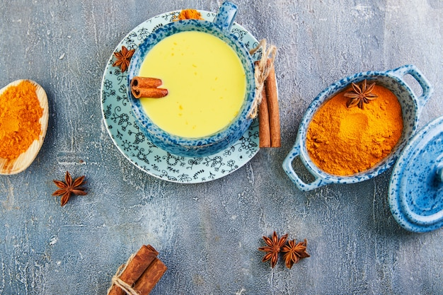 Golden latte turmeric healthy drink in a blue cup