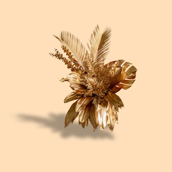 Golden leaf cluster with bright gray background and sun shadow tropical summer concept