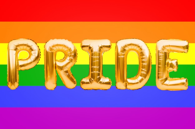 Golden letters made from balloons forming word pride on lgbt pride flag background