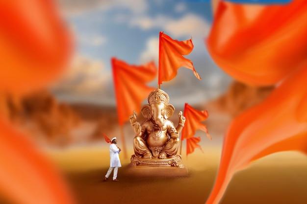 Скульптура золотого лорда ганеши с оранжевым флагом
