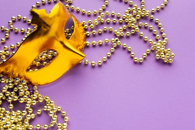 Golden mask and pearl decorations