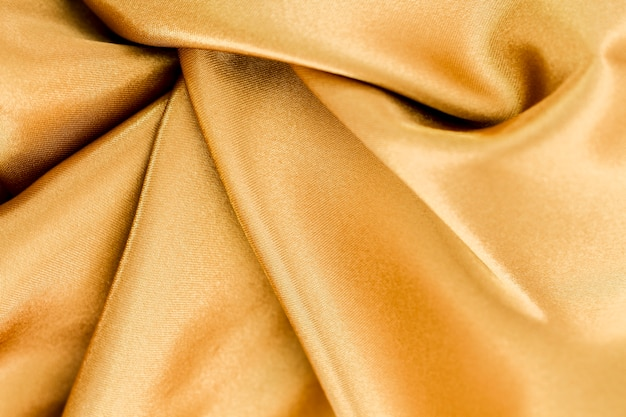 Golden material surface with twisted waves