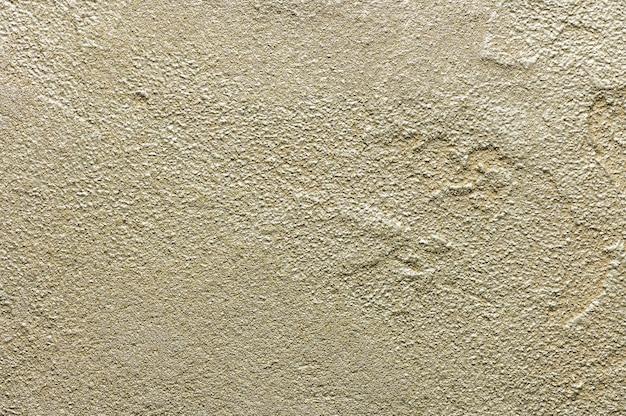 황금 지저분한 벽 치장 용 벽 토 텍스처입니다. 배경에 대 한 근접 촬영 장식 석고 페인트입니다.
