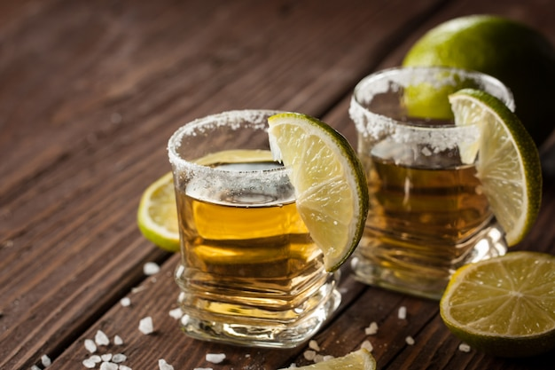 Golden mexican tequila with lime