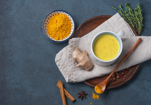 Golden milk with turmeric and cinammon. diet, healthy, and detox drink. trendy drink. top view