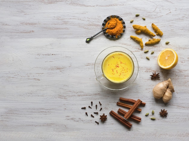 Golden milk with turmeric, cinnamon,ginger, lemon and pepper. prevention of antiviral infections