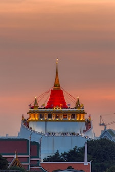 Golden mount temple fair, golden mount temple with red cloth in bangkok at dusk