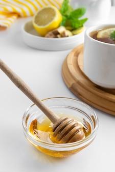 Golden natural honey autumn winter hot drink ingredient glass bowl honey spoon seasonal