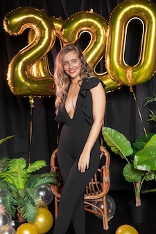 Golden new year 2020 balloons and beautiful girl