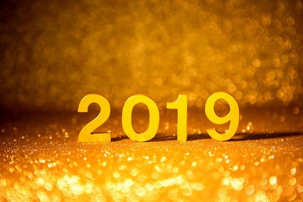 Golden number 2019 placed on dark elegant glamour night gold glitter tone