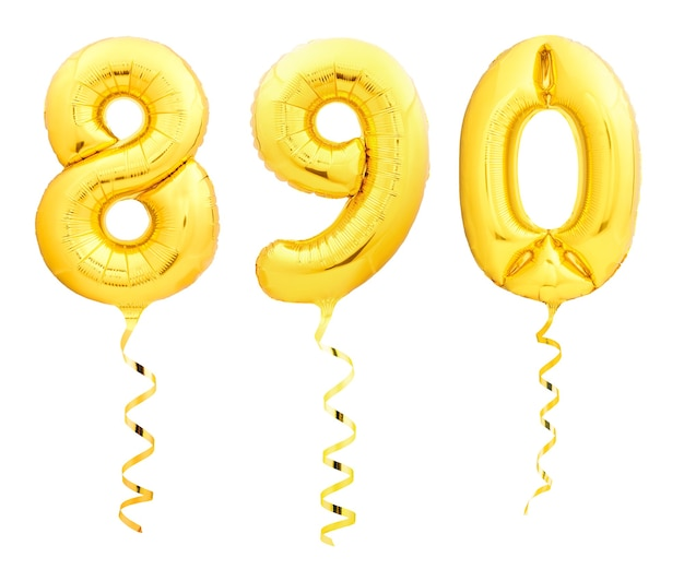 Golden numbers 8, 9, 0 made of inflatable balloons with golden ribbons isolated on white background