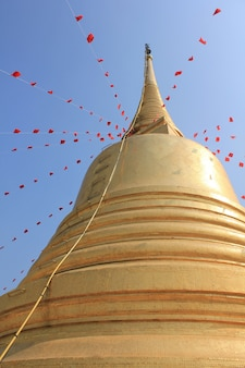 Golden pagoda adorned with many colors.