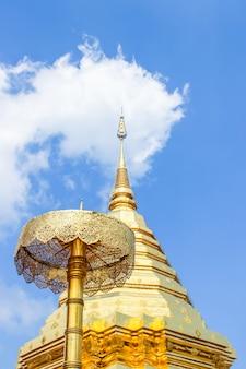 Golden pagoda and umbrella in wat phra that doi suthep is the popular tourist destination.