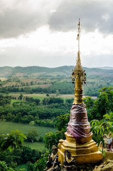 The golden pagoda view in natural environment on a mountain